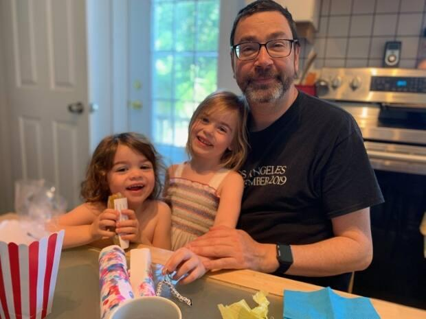 Greg MacIsaac is shown with his daughters, aged two and five. The family is planning to visit Antigonish this summer. (Greg MacIsaac - image credit)