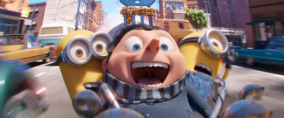 """This image released by Illumination Entertainment and Universal Pictures shows characters, from left, Kevin, Gru, voiced by Steve Carell and Stuart in a scene from """"Minions: The Rise of Gru.""""  Universal Pictures said Thursday, March 19, 2020, that the animated film will not be completed by July 3 due to circumstances surrounding the coronavirus. (Illumination Entertainment and Universal Pictures via AP)"""
