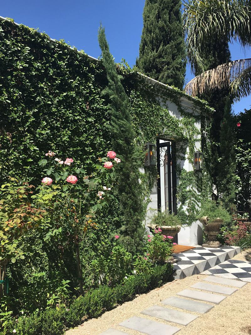"""The lush greenery covers much of the exterior walls of supermodel Georgia Fowler's home. """"I love creating spaces that are rich, serene and balanced,"""" says Alice Cheng of Shialice Spatial Design. """"The underlying goal is a livable luxury."""""""