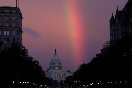 A rainbow forms over the U.S. Capitol as evening sets on midterm Election Day in Washington