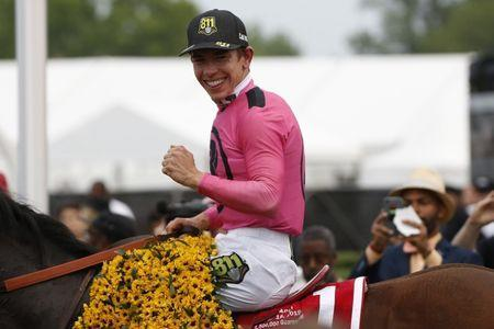 May 18, 2019; Baltimore, MD, USA; Jockey Tyler Gaffalione celebrates aboard War of Will in the WinnerÕs Circle after winning the 144th running of the Preakness Stakes at Pimlico Race Course. Geoff Burke-USA TODAY Sports