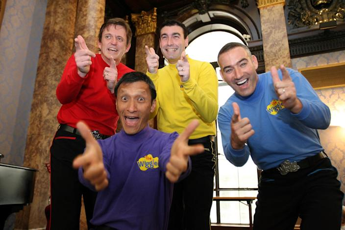 FILE - In this June 28, 2006 file photo, Australian children's entertainers The Wiggles, Murray Cook (Red Wiggle), Greg Page (Yellow Wiggle), Jeff Fatt (Purple Wiggle), and Anthony Field (Blue Wiggle) make a special appearance at the Australian High Commission in London at the start of their UK tour. Three members of the world-famous preschool quartet The Wiggles will be hanging up their colorful outfits and leaving the Australian band this year, with the Blue Wiggle the lone original member left dancing, the band said in a statement Thursday, May 17, 2012. (AP Photo/Christopher Pledger, File)