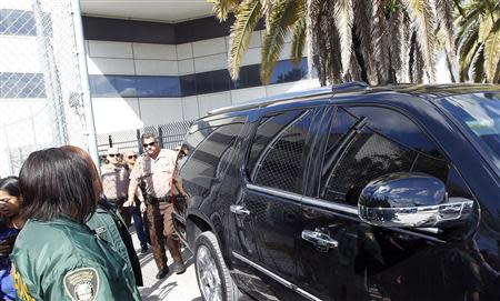 The vehicle carrying teen pop star Justin Bieber departs from a Miami-Dade County jail in Miami, Florida January 23, 2014. REUTERS/Andrew Innerarity