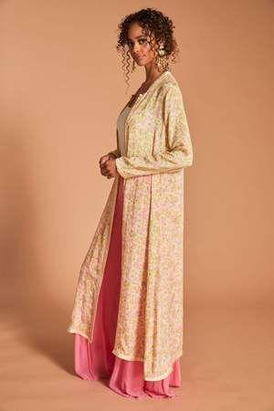 """<p>sanidesigns.com</p><p><strong>$120.00</strong></p><p><a href=""""https://sanidesigns.com/collections/capes/products/bharti-cape"""" rel=""""nofollow noopener"""" target=""""_blank"""" data-ylk=""""slk:Shop Now"""" class=""""link rapid-noclick-resp"""">Shop Now</a></p><p>Ok, ok, so this technically isn't a cover-up. But the traditional Indian silky vintage fabric is super versatile. Wear it with your favorite bathing suit, jeans and a t-shirt with some cute wedges, or any of your ethnic wear for a fun, unique pop of color and texture.</p>"""