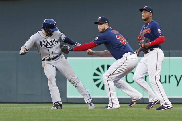Tampa Bay Rays' Austin Meadows, left, is tagged out in a rundown by Minnesota Twins first baseman C.J. Cron during the fourth inning of a baseball game Wednesday, June 26, 2019, in Minneapolis. (AP Photo/Jim Mone)