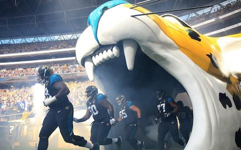 <span>Jacksonville Jaguars players enter the Wembley field for their 2016 game against the Indianapolis Colts</span> <span>Credit: Ben Hoskins/Getty Images </span>