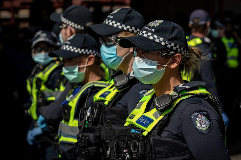 A row of female police officers wear face masks in Melbourne.