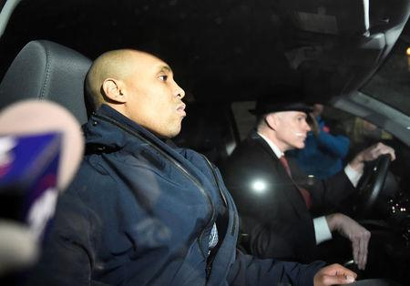 Former Minneapolis police officer Mohamed Noor and his attorney Tom Plunkett (R) leave the Hennepin County jail after posting bail in Minneapolis, Minnesota, U.S. March 21, 2018.  REUTERS/Craig Lassig