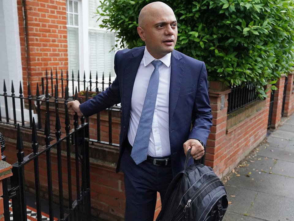 Mr Javid leaving his home on Monday morning (PA)