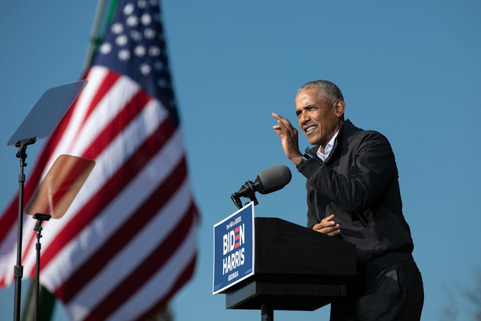 Former President Barack Obama speaks at a Drive-in Mobilisation Rally to get out the vote for Georgia Senate candidates in Atlanta, Georgia.