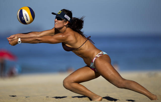 Brazil's Maria Elisa Antonelli returns a shot during a beach volleyball training match on Ipanema beach in Rio de Janeiro, Brazil, Wednesday, April 11, 2012. Antonelli and her teammate Talita Antunes are one of the favorite teams that will compete at the London 2012 Olympic games women's beach volley competition. (AP Photo/Victor R. Caivano)