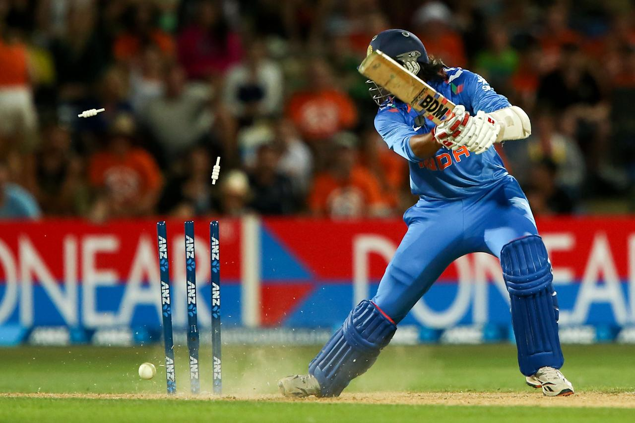 NAPIER, NEW ZEALAND - JANUARY 19:  Ishant Sharma of India is bowled out during the first One Day International match between New Zealand and India at McLean Park on January 19, 2014 in Napier, New Zealand.  (Photo by Hagen Hopkins/Getty Images)