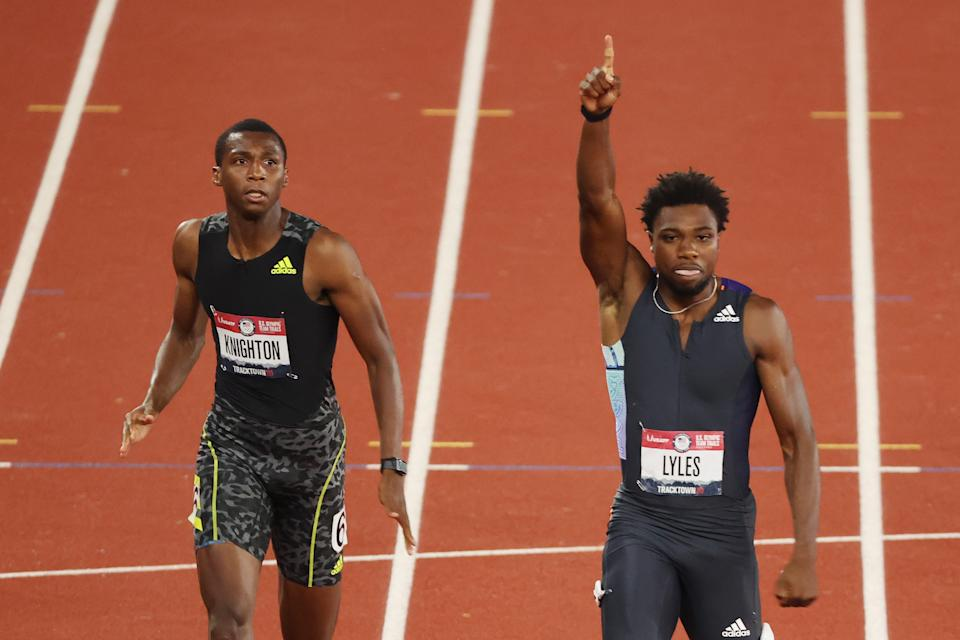 Noah Lyles (pictured right) raising his hand after winning the Men's 200 Meter Final ahead of Erriyon Knighton (pictured left).
