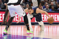 Dallas Mavericks forward Dwight Powell (7) stumbles due to injury in the first half of an NBA basketball game against the Los Angeles Clippers Tuesday, Jan. 21, 2020 in Dallas. (AP Photo/Richard W. Rodriguez)