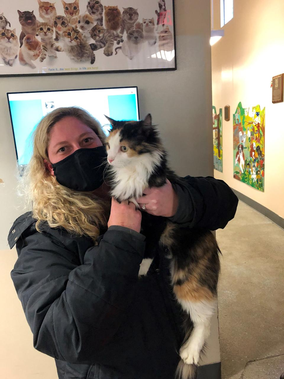 Kara Hanlon of Des Moines reunited with her cat Lottie, who got lost in 2016, thanks to the Animal Rescue League and Lottie's microchip.