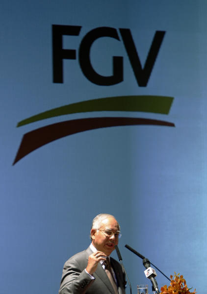 Malaysian Prime Minister Najib Razak speaks during the launch of Felda Global Ventures Holdings' prospectus in Kuala Lumpur, Malaysia, Thursday, May 31, 2012. Malaysian plantation giant Felda Global Venture Holdings says its initial public offering this month could raise as much as 10.5 billion ringgit ($3.3 billion), the second biggest after Facebook. (AP Photo/Lai Seng Sin)