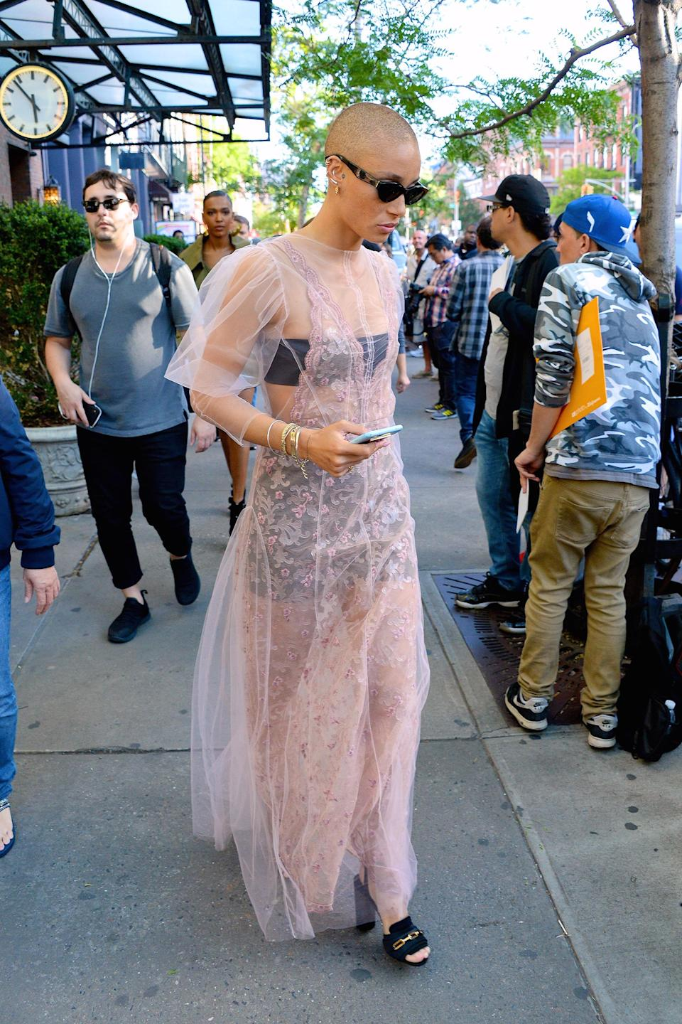 <p>Model Adwoa Aboah wore the perfect summer outfit in pink, tulle overlay dress with floral embroidery which she wore on top of a black two-piece.<br><em>[Photo: Getty]</em> </p>