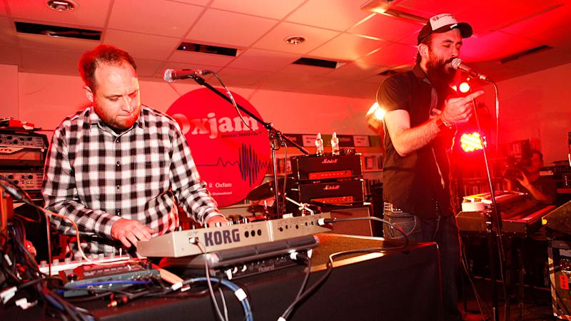 Dan Le Sac vs Scroobius Pip perform at launch of nationwide music festival 'Oxjam' at Dalston Oxfam Shop in 2010