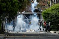 Demonstrators clashing with riot police in Cali, Colombia on June 4, 2021