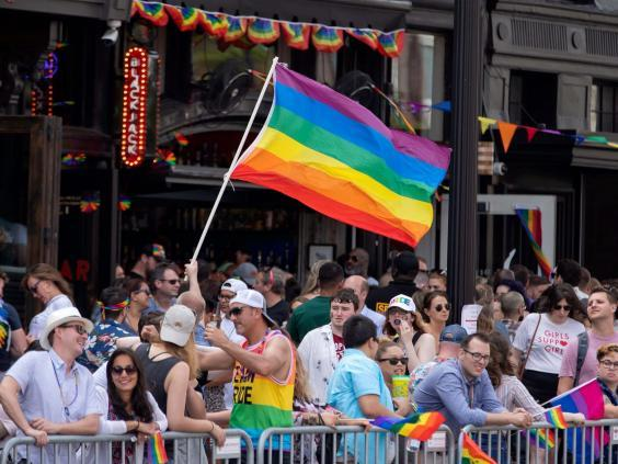 People gather to watch the DC Pride Parade in Washington, DC (EPA)