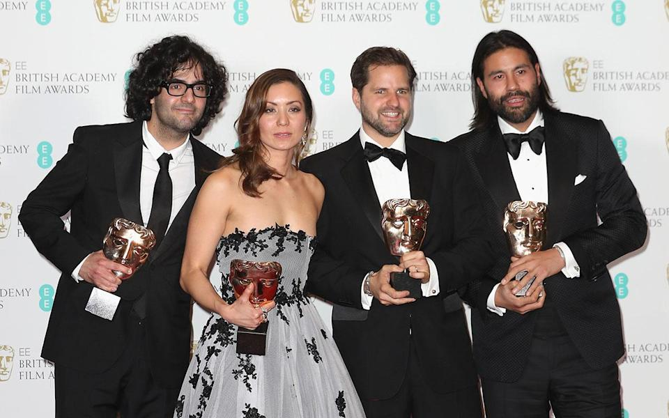 <p>Babak Anvari, Emily Leo, Oliver Roskill and Lucan Toh pose in the winners room (Credit: Chris Jackson/Getty Images) </p>