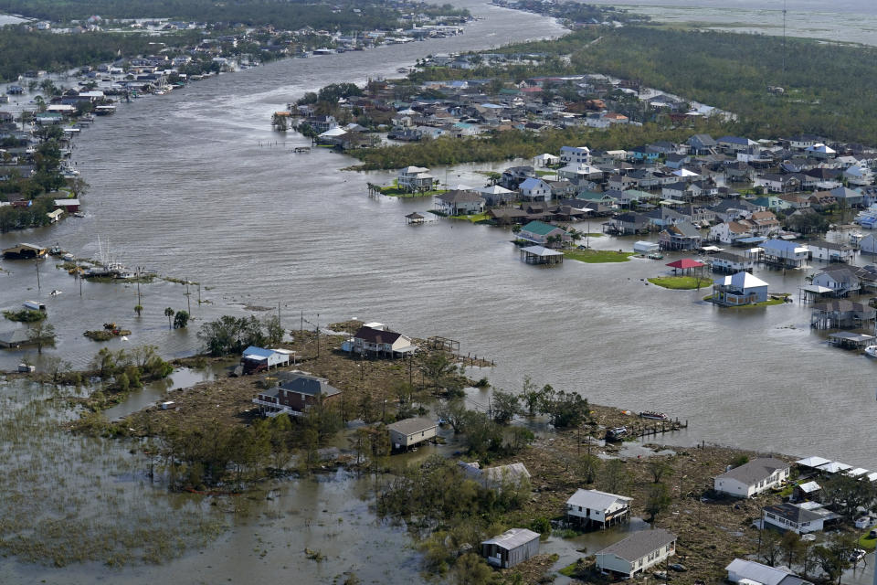 Floodwaters cover Lafitte, La., in the aftermath of Hurricane Ida, Monday, Aug. 30, 2021. (AP Photo/David J. Phillip)