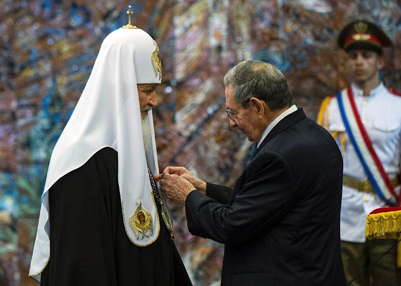 Cuban President Raul Castro decorates the head of the Russian Orthodox Church, Patriarch Kirill, with the Jose Marti Order, in Havana on February 13, 2016