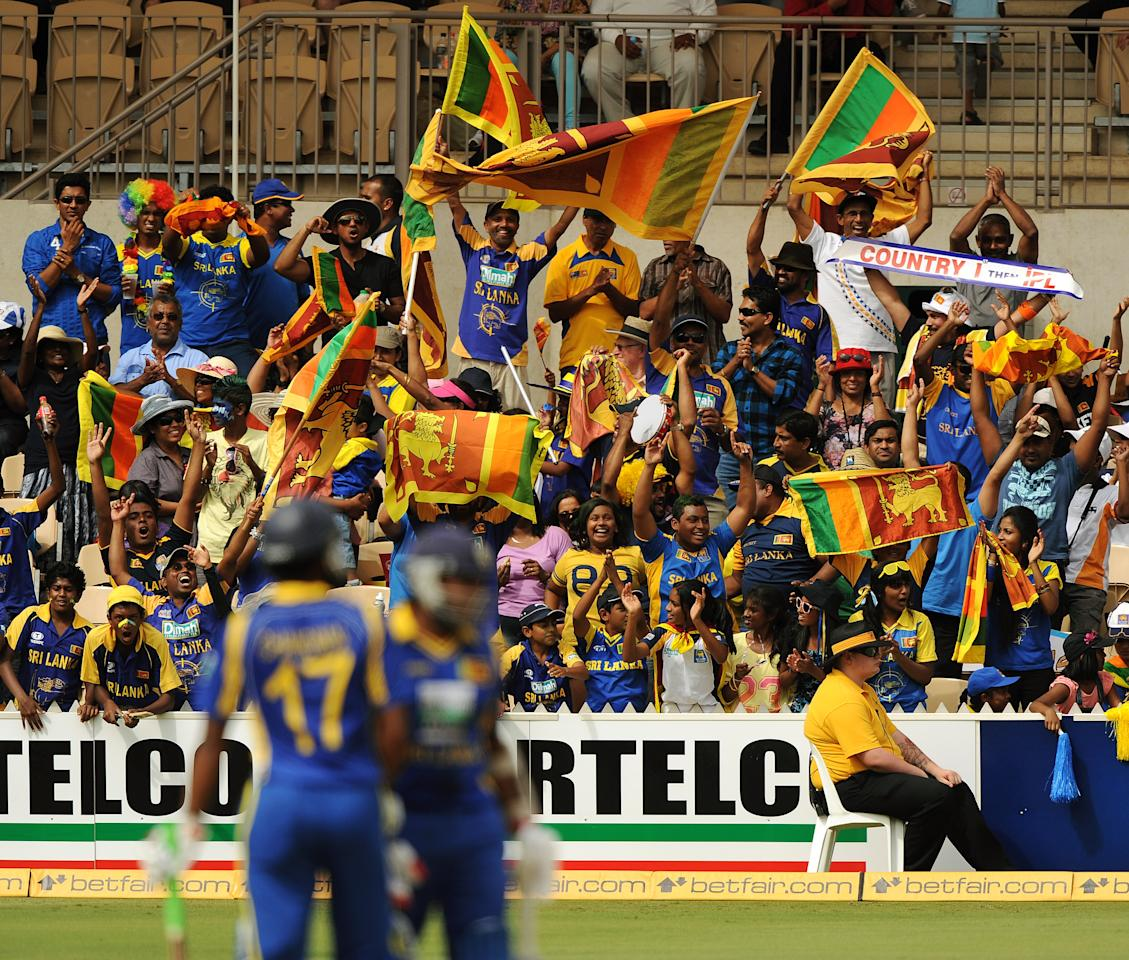 Sri Lankan fans enjoy themselves during the one day international cricket match against India in Adelaide on February 14, 2012.