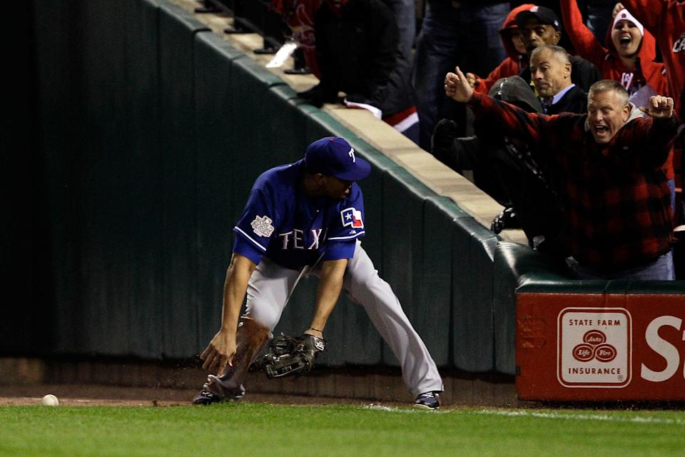 ST LOUIS, MO - OCTOBER 19: Nelson Cruz #17 of the Texas Rangers misses the fly ball hit by Allen Craig #21 of the St. Louis Cardinals, scoring David Freese #23 in the bottom of the sixth inning during Game One of the MLB World Series at Busch Stadium on October 19, 2011 in St Louis, Missouri. (Photo by Rob Carr/Getty Images)