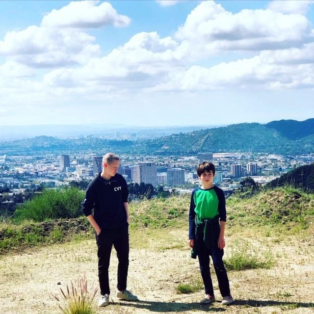 """Erin Zelle's children, Sully and Jack, on a walk during the coronavirus pandemic that shut down Los Angeles. <span class=""""copyright"""">(Erin Zelle)</span>"""
