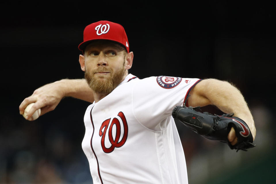 Washington Nationals starting pitcher Stephen Strasburg throws to the Philadelphia Phillies in the third inning of a baseball game, Thursday, Sept. 26, 2019, in Washington. (AP Photo/Patrick Semansky)