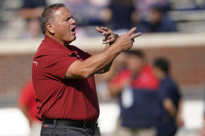 Arkansas head coach Sam Pittman gestures to his players as they warmup prior to their NCAA college football game against Mississippi, Saturday, Oct. 9, 2021, in Oxford, Miss. Mississippi won 52-51. (AP Photo/Rogelio V. Solis)