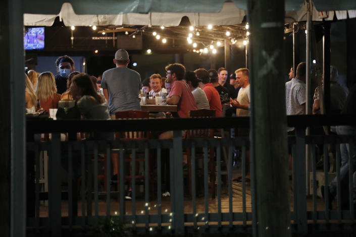 Patrons pack a bar to have drinks on the first day of full capacity seating is allowed on September 25, 2020 in Tampa, Florida. (Octavio Jones/Getty Images)