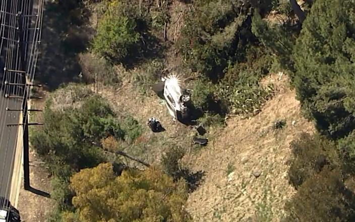 Woods' car on its side off the road in Rancho Palos Verdes - AP
