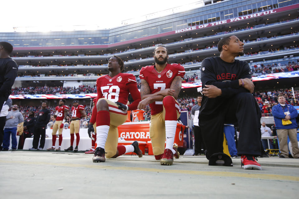 SANTA CLARA, CA - JANUARY 1: Eli Harold #58, Colin Kaepernick #7 and Eric Reid #35 of the San Francisco 49ers kneel on the sideline, during the anthem, prior to the game against the Seattle Seahawks at Levi Stadium on January 1, 2017 in Santa Clara, California. The Seahawks defeated the 49ers 25-23. (Photo by Michael Zagaris/San Francisco 49ers/Getty Images)