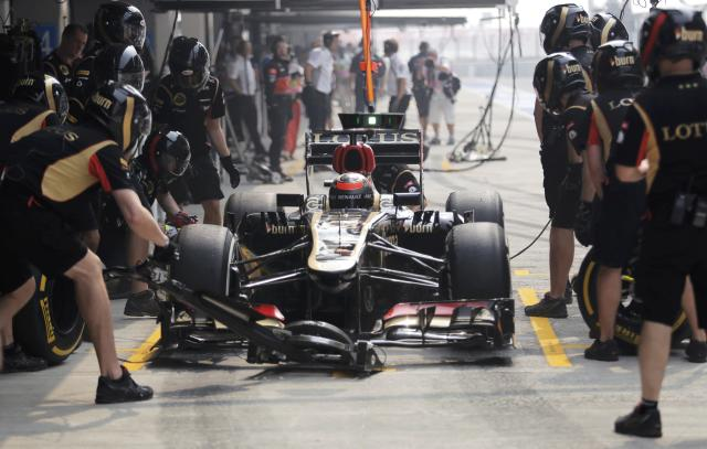 Lotus F1 Formula One driver Kimi Raikkonen of Finland is seen in his car during the third practice session of the Indian F1 Grand Prix at the Buddh International Circuit in Greater Noida, on the outskirts of New Delhi, October 26, 2013. REUTERS/Anindito Mukherjee (INDIA - Tags: SPORT MOTORSPORT F1)