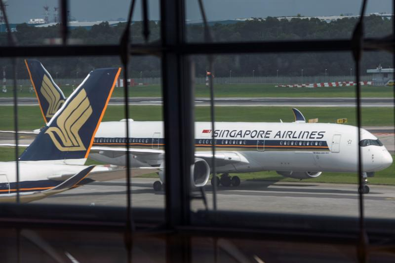 A Singapore Airlines passenger jet taxis along the tarmac as it arrives at Changi International Airport terminal in Singapore on June 8, 2020, as Singapore prepares to reopen its borders after shutting them to curb the spread of the COVID-19 novel coronavirus. (Photo by Roslan RAHMAN / AFP) (Photo by ROSLAN RAHMAN/AFP via Getty Images)