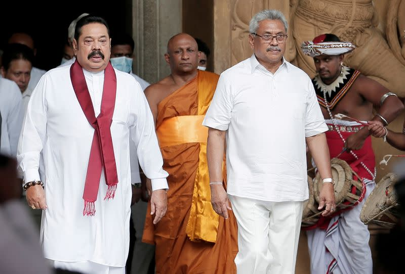 FILE PHOTO: Sri Lanka's Prime Minister Mahinda Rajapaksa and his brother, and Sri Lanka's President Gotabaya Rajapaksa are seen during his during the swearing in ceremony as the new Prime Minister, at Kelaniya Buddhist temple in Colombo