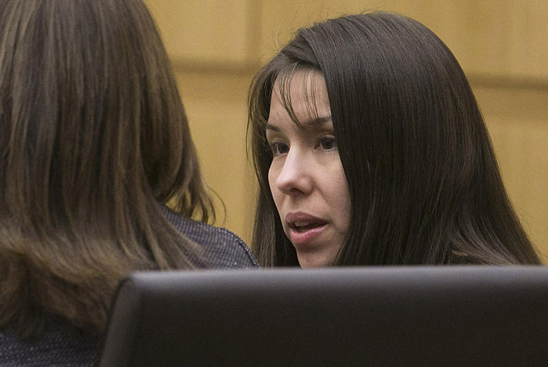 Defendant, Jodi Arias, right, talks with her defense team during the prosecution's opening statements in the trial of Arias in Maricopa County court in Phoenix on Wednesday, Jan. 2, 2013.  Arias is charged in the murder of her boyfriend, Travis Alexander.   (AP Photo/The Arizona Republic, David Wallace)  MARICOPA COUNTY OUT; MAGS OUT; NO SALES