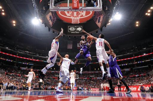 LOS ANGELES, CA - APRIL 7: Terrence Williams #55 of the Sacramento Kings goes up for a shot against Eric Bledsoe #12 and Nick Young #11 of the Los Angeles Clippers at Staples Center on April 7, 2012 in Los Angeles, California. (Photo by Noah Graham/NBAE via Getty Images)