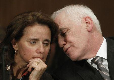Federal Reserve Board Governor Tarullo confers with Miller, Federal Reserve Undersecretary for Domestic Finance, before Senate Banking, Housing and Urban Affairs Committee in Washington