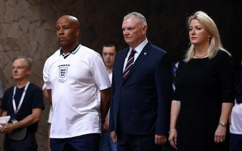 Football Supporters' Federation (FSF) National Council member Billy Grant, The CEO of the UK's Football Association Greg Clark, and British Deputy Ambassador in Russia Lindsay Skoll (L-R front) during a wreath laying ceremony at the Hall of Military Glory - Credit: Getty Images