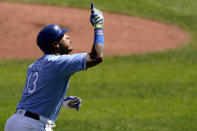 Kansas City Royals' Salvador Perez celebrates after hitting a two-run home run during the first inning of a baseball game against the Oakland Athletics Thursday, Sept. 16, 2021, in Kansas City, Mo. (AP Photo/Charlie Riedel)