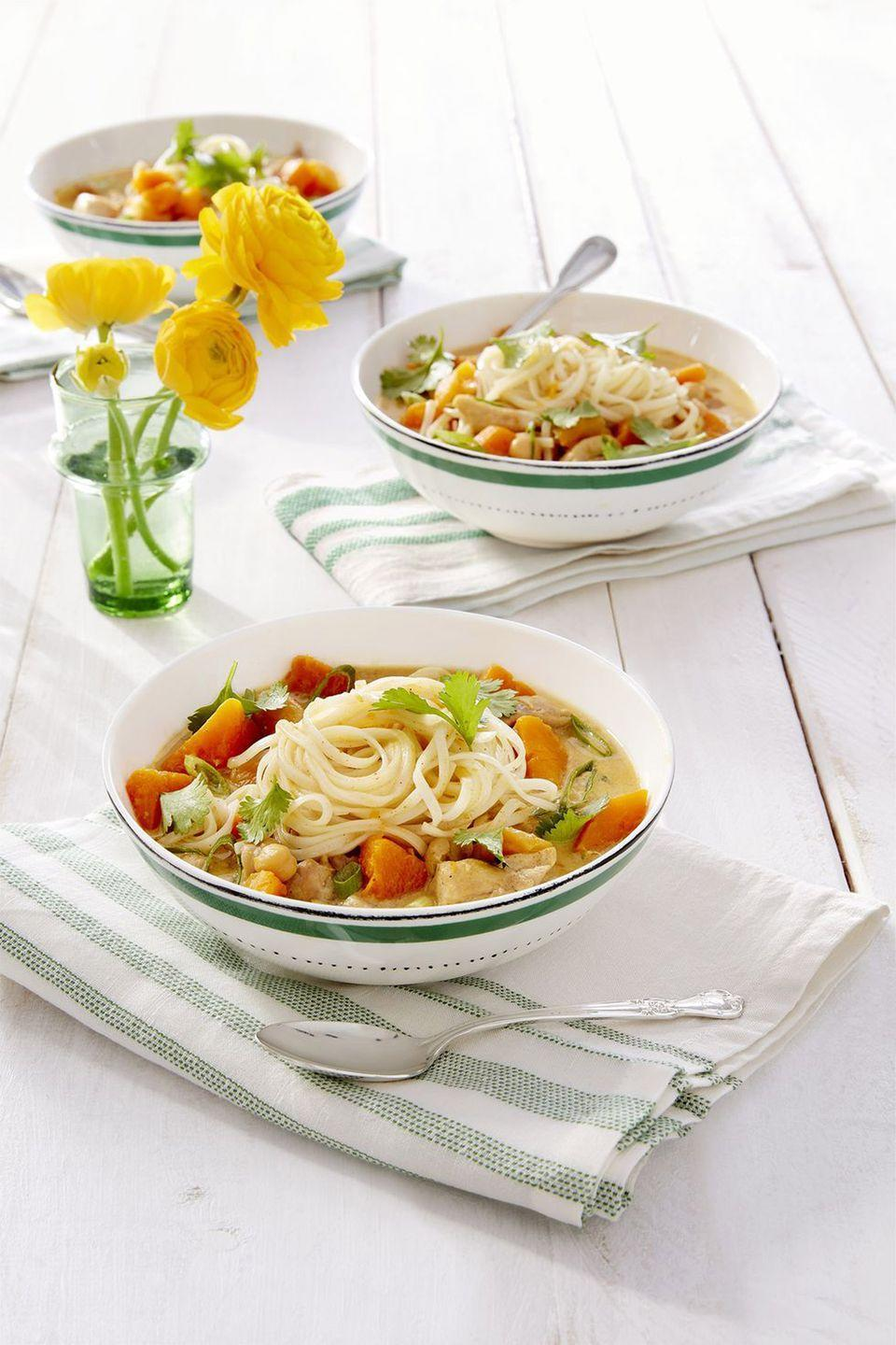 "<p>Dried apricots, chickpeas, and tender bites of butternut squash make for a filling lunch or dinner dish.</p><p><strong><a href=""https://www.countryliving.com/food-drinks/a16571156/butternut-squash-apricot-chicken-noodle-curry-recipe/"" rel=""nofollow noopener"" target=""_blank"" data-ylk=""slk:Get the recipe"" class=""link rapid-noclick-resp"">Get the recipe</a>.</strong></p><p><strong><a class=""link rapid-noclick-resp"" href=""https://www.amazon.com/Tramontina-80131-035DS-Enameled-5-5-Quart/dp/B077BHPZGC/?tag=syn-yahoo-20&ascsubtag=%5Bartid%7C10050.g.3569%5Bsrc%7Cyahoo-us"" rel=""nofollow noopener"" target=""_blank"" data-ylk=""slk:SHOP DUTCH OVENS"">SHOP DUTCH OVENS</a><br></strong></p>"