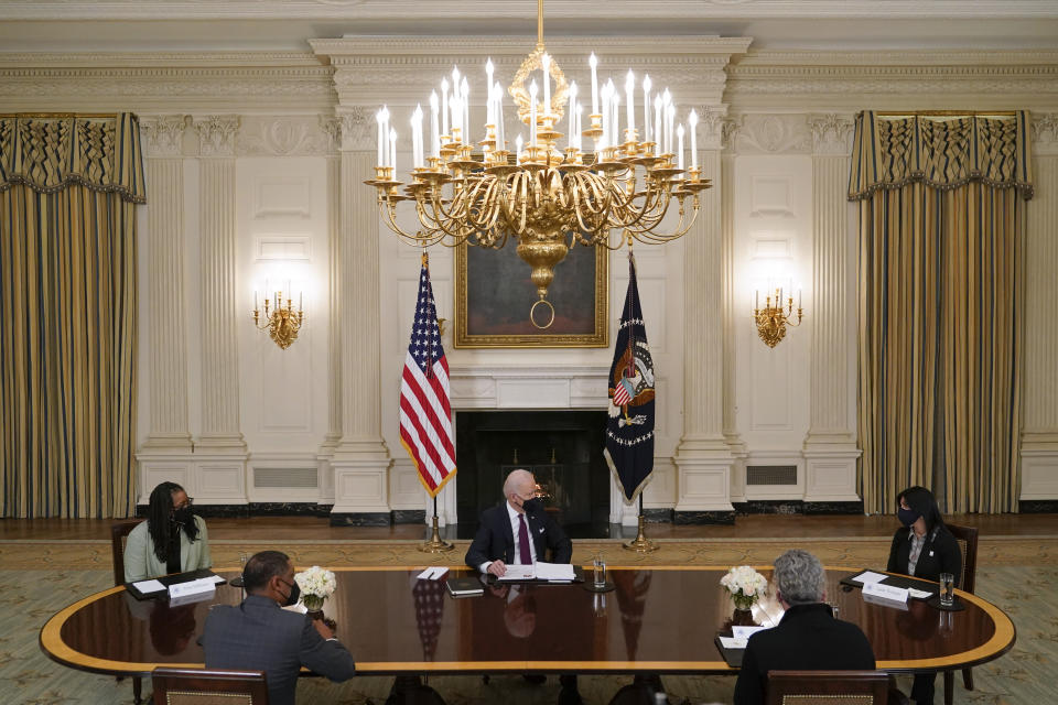 President Joe Biden participates in a roundtable discussion on a coronavirus relief package in the State Dining Room of the White House in Washington, Friday, March 5, 2021. (AP Photo/Patrick Semansky)
