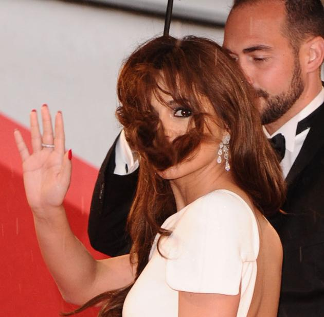 Celebrity photos: Cheryl Cole looked like an absolute goddess on the Cannes red carpet, but she did have one less than perfect moment when a gust of wind blew her hair all over her face. The star still managed to look blimmin' amazing, though.