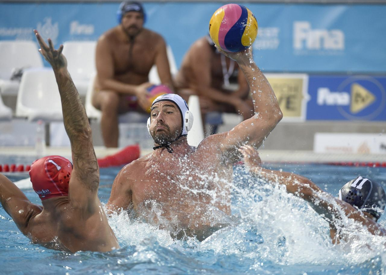 <p>Tibor Benedek, centre, of Millenium team of Hungary and Michele La Mazza, left, and Valente Massi, right, of Pallanuoto Milano A.S. Dilett of Italy fight for the ball during the men's masters water polo match Millenium vs Pallanuoto Milano A.S. Dilett at the 17th FINA World Masters Championships in Hajos Alfred National Swimming Pool in Budapest, Hungary, Tuesday, Aug 8, 2017. (Balazs Czagany/MTI via AP) </p>
