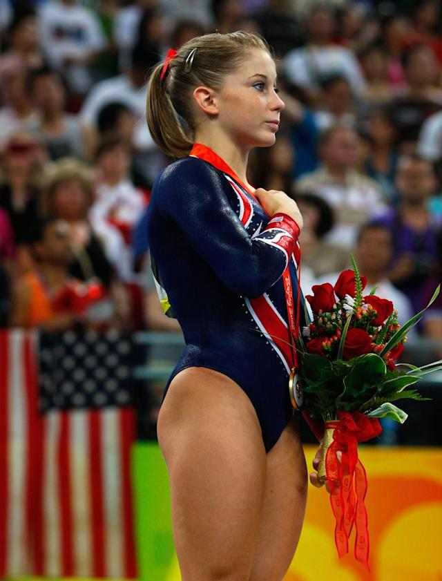 Gold medalist Shawn Johnson of the United States salutes the flag on the podium during the medal ceremony for the Women's Beam Final at the National Indoor Stadium on Day 11 of the Beijing 2008 Olympic Games on August 19, 2008 in Beijing, China.