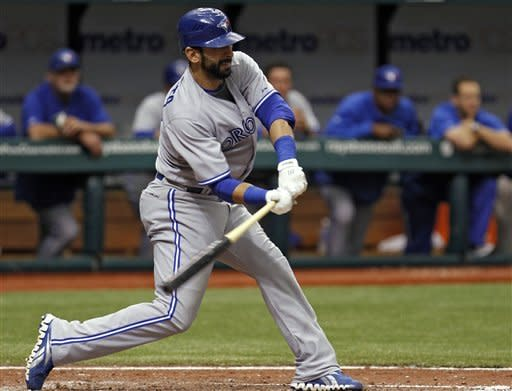 Toronto Blue Jays' Jose Bautista lines an eighth-inning double off Tampa Bay Rays relief pitcher Joel Peralta during a baseball game, Wednesday, May 23, 2012, in St. Petersburg, Fla. (AP Photo/Chris O'Meara)