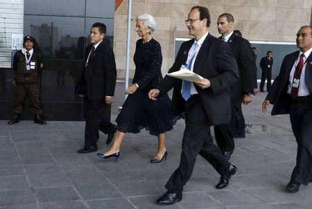 International Monetary Fund (IMF) Managing Director Christine Lagarde (C) walks at the venue of the 2015 IMF/World Bank Annual Meetings in Lima, Peru, October 9, 2015.   REUTERS/Guadalupe Pardo